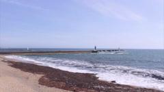 Porto Ocean View and Senhora da Luz Lighthouse Jetty Stock Footage