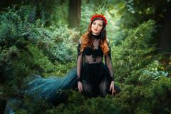 Beautiful girl is in the fairy forest. Stock Photos