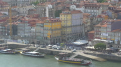 Boats anchored on Douro River in Porto Stock Footage