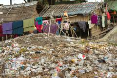 Rubbish in slum area - stock photo