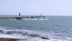 Porto Ocean View and Senhora da Luz Lighthouse Jetty (medium shot) Stock Footage