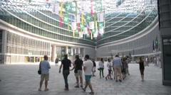 Palazzo Lombardia - tourists come to the building Stock Footage