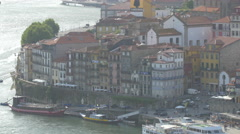 View of old multicolored buildings on Douro riverside in Porto Stock Footage