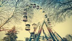 Retro old film faded picture of ferris wheel in a park. Stock Photos