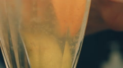 the pulp of lemon floating in the glass - stock footage