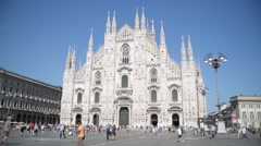 Duomo in Milan - the crowds of tourists walk on the square - stock footage