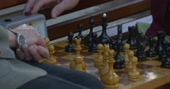 Two Men Are Sitting in Front of Each Other on The Bench, Playing Chess, Turn Stock Footage