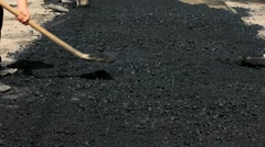 Manual Labor on the Distribution of Asphalt on the Road Section . Repair Work on Stock Footage