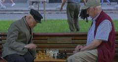 Two Men Are Sitting in Front of Each Other on The Bench, Senior Aged Men in Stock Footage