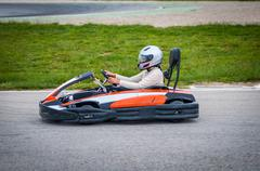 Woman driving a kart - stock photo
