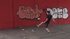 Man playing with football - stock footage