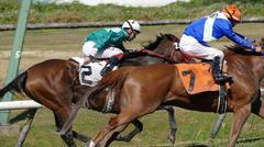 Horse Racing - Two Jockeys at Close Chase - stock photo