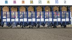 Horse Racing - Jockeys at Track Gates Before Start - stock photo