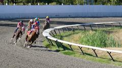 Horse Racing - Jockeys Riding On Track Curve - 03 - stock photo