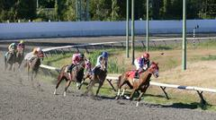 Horse Racing - Jockeys Passing Track Curve - stock photo
