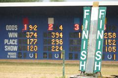 Horse Racing - Track & Scoreboard - Close Finish Sign - stock photo