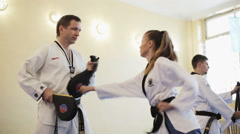 Taekwondo Coach Young Athlete Prepares For Battle - stock footage