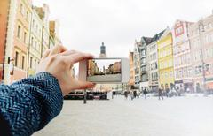 taking a picture of the old city of Wroclaw in Poland - stock photo