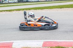 Woman driving a kart Stock Photos
