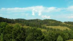 4K Timelapse of clouds and beautiful green mountains with coniferous trees - stock footage