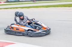 Man driving a Kart Stock Photos