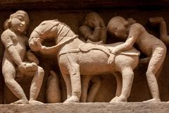 Famous erotic stone carving bas relieves, Lakshmana Temple, Khajuraho, India. Stock Photos