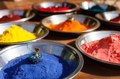 Stock Photo of India symbol. Colored colorful powder kumkum in bowls on Indian bazaar for Ho