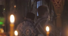 Crowd of Orthodox Clergy Orthodox Abbot named Paul Burning Candles Close Up - stock footage