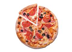 Top view of delicious pizza with ham and tomatoes with a slice removed - stock photo