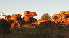 Devils marbles/ karlu karlu at sunset zoom in Stock Footage