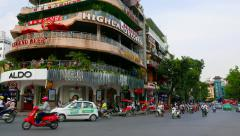 Evening traffic on round about. Hanoi. Panning. Stock Footage