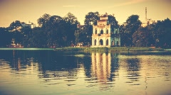 Turtle Tower on Hoan Kiem lake. Hanoi. 4K resolution retro look. Stock Footage