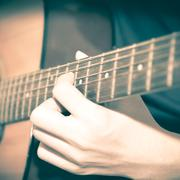 still life man playing guitar - stock photo