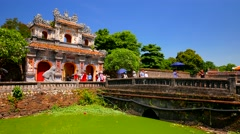 Visitors exiting Citadel by ancient gate. Hue. 4K resolution. Stock Footage