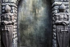 Knight Protectors Stone Statues and Cracked Grunge Wall Background Stock Photos