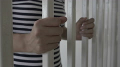 4K : Hands of the Asian prisoner behind the jail Stock Footage