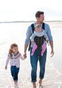 Father and Children on Beach - stock photo