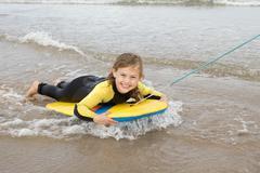 Girl Bodyboarding - stock photo