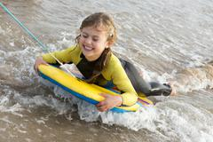 Girl on Bodyboard - stock photo