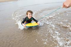 Boy Bodyboarding - stock photo