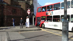 People getting out of the double-decker bus in England Stock Footage