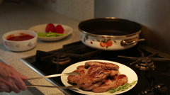 Serial videos of a housewife cooking beef in a cooker with tomatoes Stock Footage