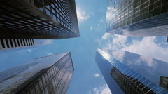 Blue sky and clouds reflected on skyscrapers facades in NYC - stock footage