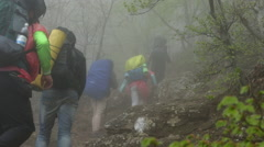Hikers Trekking Up Mountain in Strong Fog Stock Footage