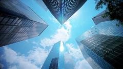 Sky and clouds reflected on glass facades of NYC skyscrapers Stock Footage