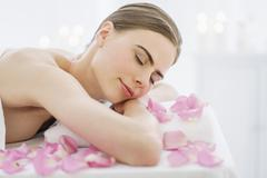 Young woman during beauty treatment - stock photo