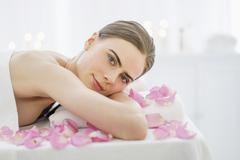 Portrait of young woman during beauty treatment Stock Photos