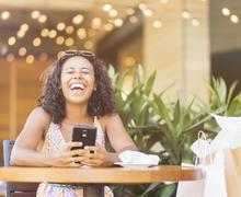 Woman using phone in cafe Stock Photos