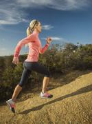Stock Photo of Woman running in mountains