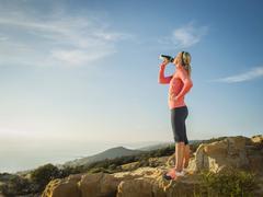 Stock Photo of Woman in sportswear drinking water